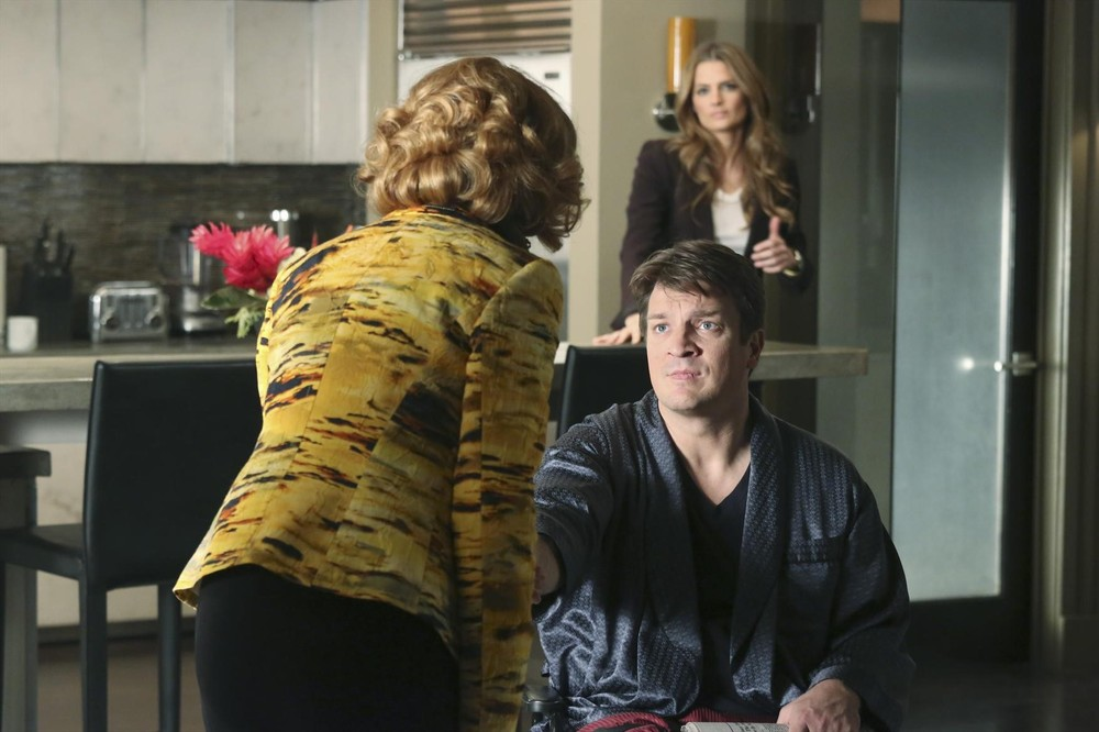 """CASTLE - """"The Lives of Others"""" -- In the show's 100th episode, Castle finds himself in the unfortunate position of NOT being able to work a case. While he's holed up in the loft with a broken leg, Beckett goes off to investigate the death of an IRS agent without him, leaving Castle miserable and bored. But when he thinks he witnesses the murder of a young woman in the apartment across the street, he is thrown into a """"Rear Window""""-esque murder mystery that hits much too close to home, on """"Castle,"""" MONDAY, APRIL 1 (10:01-11:00 p.m., ET), on the ABC Television Network. (ABC/Richard Cartwright) SUSAN SULLIVAN, NATHAN FILLION, STANA KATIC"""