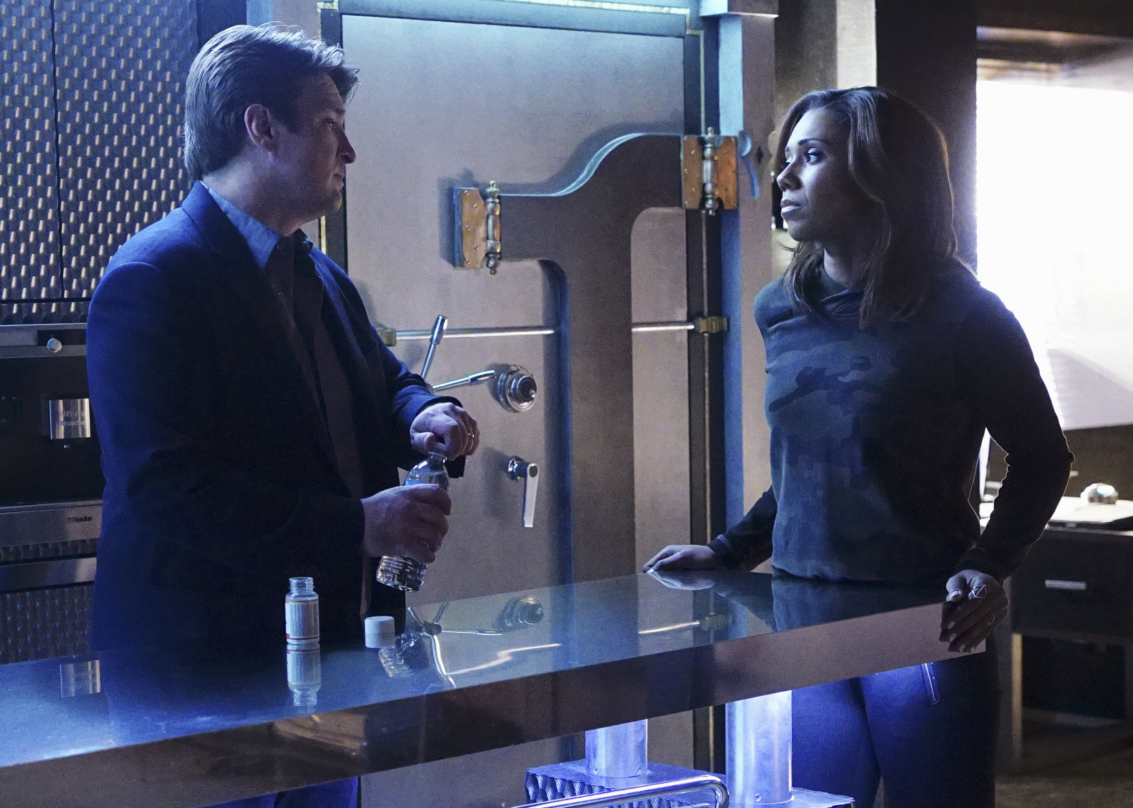"""CASTLE - """"Fidelis Ad Mortem"""" - When a recruit officer at the NYPD Academy is killed, Beckett and the team go back to their old training ground to investigate. Meanwhile, Castle must reckon with a decision with profound consequences for him and Beckett, on """"Castle,"""" MONDAY, MARCH 21 (10:01-11:00 p.m. EDT), on the ABC Television Network. (ABC/Richard Cartwright) NATHAN FILLION, TOKS OLAGUNDOYE"""